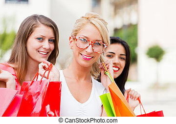 Three Women Out In Town Shopping