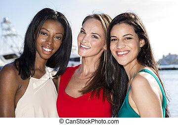 Three women posing in marina harbor