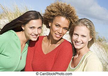 Three women posing outdoors