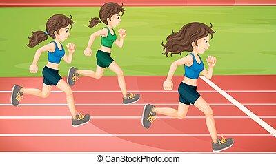 Three women running in the track