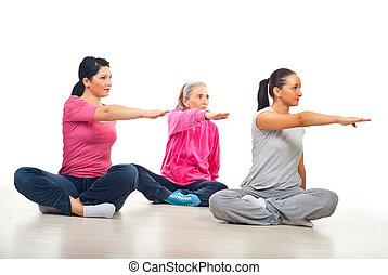 Three women stretching hands