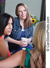 Three Women Talking - Happy woman talks with two friends on...