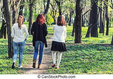 Three women walking away