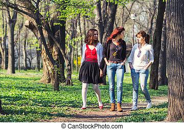 Three women walking in the park