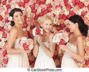 three women with background full of roses - beautiful three...