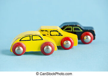 three wooden and old car toys