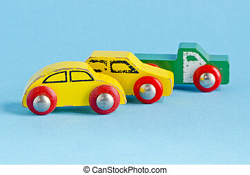 three wooden cars toys on azure background