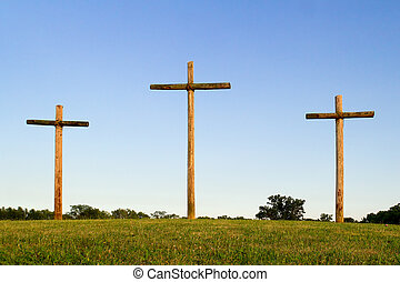 Three Wooden Crosses on Hill - Three, rugged, wooden crosses...