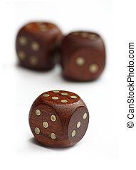 three wooden dice