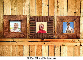Three wooden frames with family photos