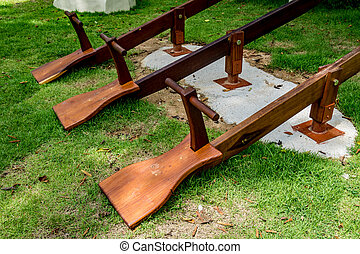 Three wooden seesaw