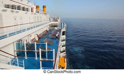 workers cleans deck of cruise ship - three workers cleans...