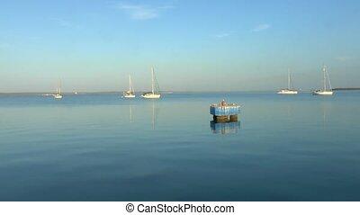 Three Yachts in Marina after Sunris