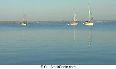 Three yachts near marine after sunrise, Cienfuegos, Cuba