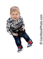 three-year boy sitting on a white background