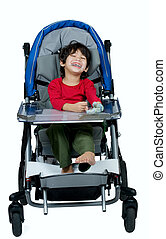 Three year old biracial disabled boy in medical stroller, happy