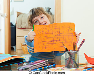 three year old child drawing on paper