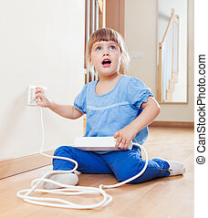 three year old child playing with electricity