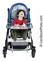 Three year old disabled boy in medical stroller