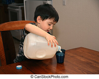 Three Year Old Pouring Milk - Adorable three year old boy...