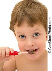 Three years child brushing teeth isolated on white