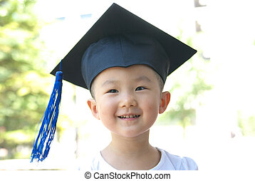 child with gown hat