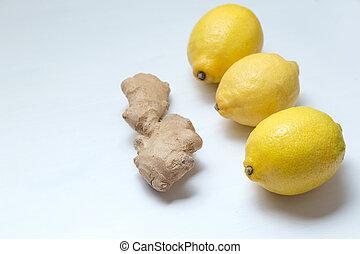 Three yellow lemons and ginger root.