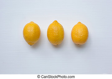 Three yellow lemons with on white.