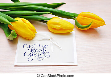 Three yellow tulips with greeting card thank you