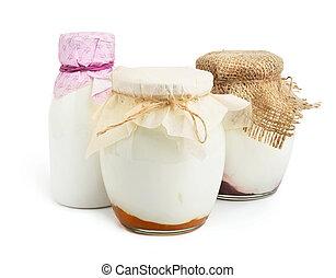 Three yogurts on white background