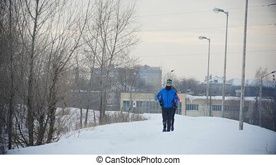 Three young athletes running in winter outdoor, sport and...