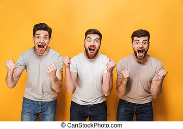 Three young happy men celebrating success together
