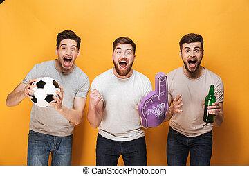 Three young happy men football fans celebrating