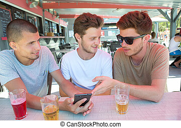 Three young lads at the bar
