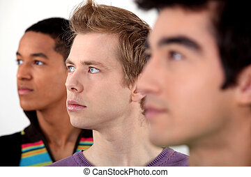 three young man in profile