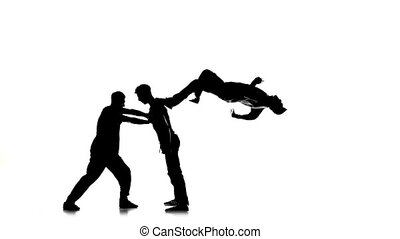 Three young men dancing hip-hop, breakdance on white, silhouette, slow motion