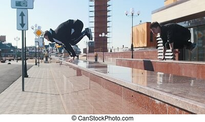 Three young men overcoming obstacles on the urban streets....