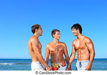 Men Relaxing On the Beach