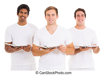 three young men singing from church hymnal