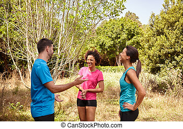 Three young runners taking a break - Group of three young...
