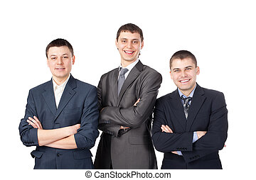 Three young smiling business men standing with folded hands isolated on white background