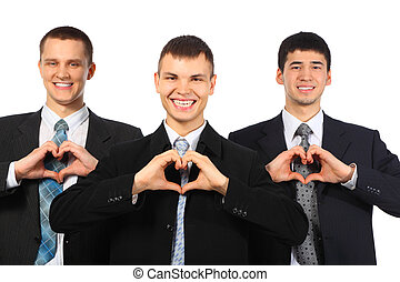 Three young smiling businessmen show love sign from hands -...