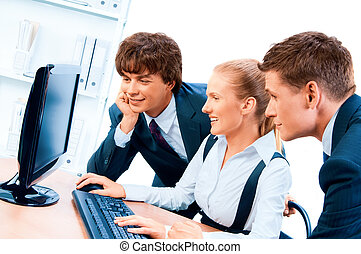 Three young successful businesspeople. Screen has a clipping path.