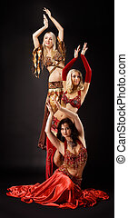 Three young woman  dance in arabic costume