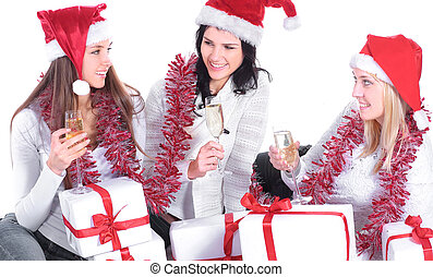three young women in hats of Santa Claus with Christmas gifts a