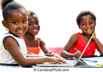 Threesome African kids with laptop at table. - Portrait of...