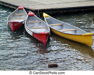 threesome - Three canoes in the water.