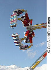 Thrill Ride - thrill ride in action at an amusement park...