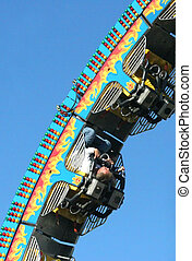 Thrill Rider - man riding roller coaster screaming with...