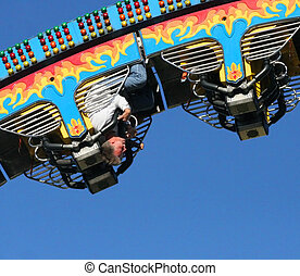 man riding roller coaster screaming with excitement - close up/detail